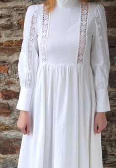 Laura Ashley Vintage 1970's White Edwardian Maxi Dress-  For many in Middle America Laura Ashley was the alternative between rag-tag hippie and urban funk styles.  And yes, we wore them without bras.  this lady has on a slip for modesty