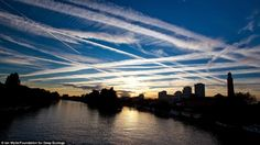 Trails of excessive air traffic over London.