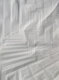 Artist Simon Schubert uses paper as both his canvas and his brush by folding the delicate material to create his unbelievably realistic images. Focusing primarily on architectural landscapes, Schubert manages to recreate curving perspectives of winding staircases and arched windows in addition to the endless geometric details in each created environment simply by meticulously creasing the page.