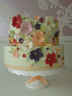 Wonderful fresh garden cake with sugar blooms in happy colours.