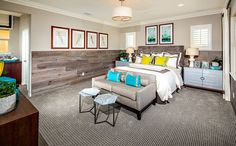 The home's second level features a spacious master bedroom and bath suite with large walk-in closet, separate shower and tub, and dual sinks.  - Residence 1 at Hampshire at College Park in Chino, CA