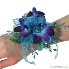 Dream Corsage by Viviano Flower Shop ~ A big favorite, with blue-dyed lavender orchids, aqua bling, and sparkling turquoise ribbon! Especially awesome with navy, purple, and aqua dresses. #prom #homecoming
