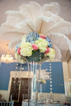 We LOVE this! Floral and feathers wedding centerpiece. Inspiration Week:  Modern Marie Antoinette