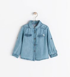 Image 2 of DENIM SHIRT WITH FLORAL DETAIL from Zara