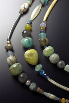 Jane Adam: necklaces in oxidised silver or silver and gold bimetal with semi-precious stones  Average length 450mm