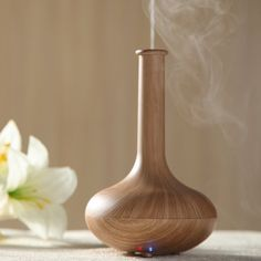 Woodgrain Ultrasonic Aromatherapy Diffuser / The Woodgrain Ultrasonic Aromatherapy Diffuser from ECVISION is a vase shaped aroma diffuser and air humidifier. http://thegadgetflow.com/portfolio/woodgrain-ultrasonic-aromatherapy-diffuser/
