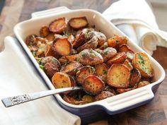 Ultra-Crispy New Potatoes With Garlic, Herbs, and Lemon | There's literally no meal that doesn't benefit from a pile of these spuds by its side. It takes a little extra effort to do the boiling, bashing, and roasting that our recipe calls for, but you'll be well-rewarded with a richly creamy interior surrounded by a browned, craggy, crunchy crust that stays nice and crisp, even after a few passes around the table.  #fathersday #fathersdayinspiration #seriouseats #recipes #potatoes