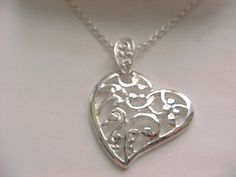 I'm auctioning 'Silver plated scrolled heart necklace' on #tophatter