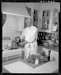 Alfred Lunt Stirs a Sauce in the Kitchen at Ten Chimneys; Genesee Depot, WI    I love this kitchen!
