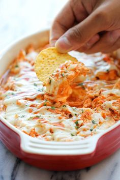 Buffalo Chicken Dip ~ chicken, refried beans, cream cheese, avocado, hot sauce & a blend of cheeses! Great game day football appetizer!