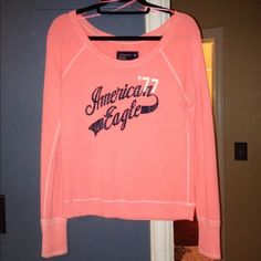 AEO Neon Orange Pullover Gently worn pullover. No flaws. Bright neon color and can be worn off the shoulder as well. Super cute! American Eagle Outfitters Jackets & Coats