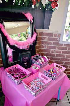 Dress-up station with bracelets, hats, feather boas, necklaces, sunglasses!