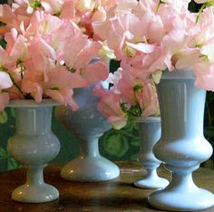 Love the pale blue vase with pale pink flowers