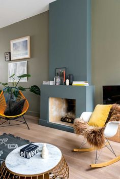 Blue and green living room with fireplace