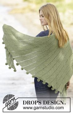 """Knitted DROPS shawl in garter st with lace pattern and pompoms in """"BabyAlpaca Silk"""" and """"Kid-Silk"""". ~ DROPS Design"""