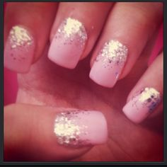 Pink nails with glitter.