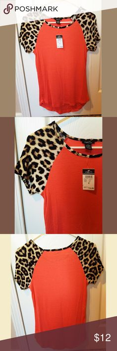Cheetah Sleeve Tee! Brand new with tags T-Shirt! Bought from rue21 the shirt has cheetah print on the sleeves and is super cute! Rue 21 Tops Tees - Short Sleeve