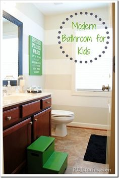 I like the neutral light colors with the dark work but the green adds flavor. Modern Bathroom Makeover for Kids on PBJstories.com