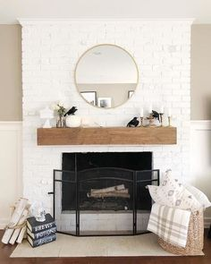 If you are looking to give your room a focal point or something to highlight it, look no further than the fireplace mantel that's already there. Many tend to leave their fireplace mantels bar… Wood Mantle Fireplace, Brick Fireplace Makeover, White Fireplace, Farmhouse Fireplace, Fireplace Remodel, Modern Fireplace, Farmhouse Interior, Fireplace Design, Mirror Above Fireplace
