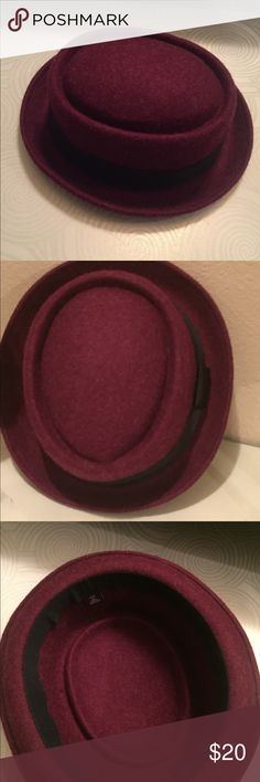 Unisex Stylish Winter Wool Hat This hat is made of 100% wool hat would jazz up or accent your winter coat or wardrobe the circumference going around is 25' inches and 9' inches across. The hat is burgundy in color accented with a black band Urban Outfitters Accessories Hats