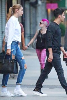 Gigi Hadid wearing Saint Laurent Classic Sac De Jour Leather Tote, Adidas Originals Superstar Sneakers and Joe's Jeans the Boyfriend Jeans in Jesenia