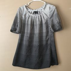 MyIt Top Printed blouse in black and white. Short sly with s zipper on the side. Excellent condition MyIt Tops Blouses