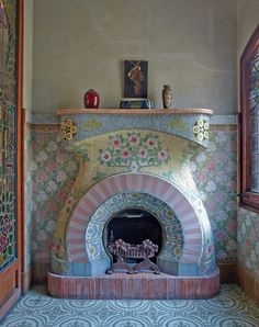 Art Nouveau fireplace from 1908 in Catalonia. A small sitting room on the top floor of the Casa Navas is dominated by an Art Nouveau style fireplace, decorated in mosaic tiles by Louis Bru. Photo by Mark Luscombe-Whyte.