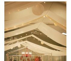Ceiling Decor for Wedding Reception, swags of fabric held in the middle by a line down the centre of the room.