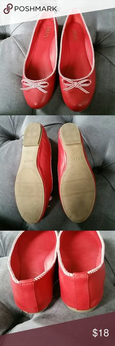 Nearly new MIA modcloth flats size 7.5 Worn once! Only wear is to bottom sole. Red with candy stripe piping and bow. Man made materials.  Purchased from modcloth.  Excellent condition. Size 7.5. MIA Shoes Flats & Loafers