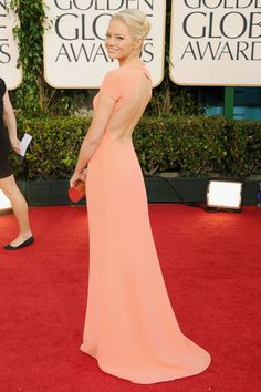 What: Calvin Klein Collection Where: Golden Globe Awards in 2011 Why: Stone cemented her status as a young Hollywood star to watch in this peach T-shirt style gown.   - HarpersBAZAAR.com