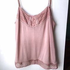 AEO Dusty Rose Tank Top Super soft tank top with adjustable straps and a crochet accented neckline and hem.  It's in almost perfect condition, the only sign of wear is a small area on the inside back of the shirt has a tiny bit of pilling. American Eagle Outfitters Tops Tank Tops