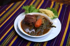 Mayan Foods and Drinks | View of a plate with 'Pepian,' a traditional Guatemalan dish, in ...