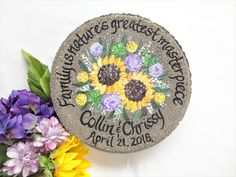 """Personalized """"hand painted"""" garden stones make the most unique gift to give to anyone for funerals, Mothers & Fathers day, memorials, weddings, birthdays and anyone who loves their garden. Pick ANY saying and ANY design in the middle! Contact www. Mother Of The Groom Gifts, Wedding Gifts For Parents, Bride And Groom Gifts, Mother Gifts, Mother Of The Bride, Personalized Garden Stones, Personalized Retirement Gifts, Bride With Glasses, Memorial Garden Stones"""