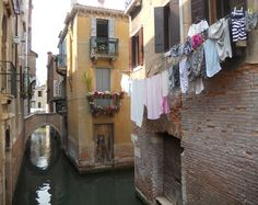washing line hanging over canal in Venice..how romantic and lovely..