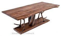 A brand new design from the artisans of Woodland Creek. This beautiful antler dining table is made with a solid wood natural live edge slab top. The base features real elk antler finished in our exclusive bronze finish. This proprietary finish has taken months to perfect. It has real copper in the finish. The thick