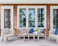 1. Channel the Hamptons. Natural wood, sandy beige and blue make a classic beach house combination that works anywhere. Unfinished teak furn...