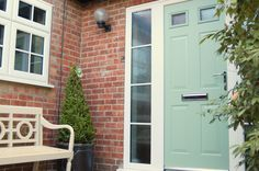 A coloured front door can completely transform your home. Composite door above is Chartwell Green