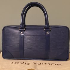 """Louis Vuitton Blue Satchel Epi leather, measurements:12.6x6.4x2.6""""/handle drop:4"""", condition;Exterior:Preowned in very good condition,Interior:preowned in good condition but fabric got faded little bit,no tears .Date Code:BA0065. Comes with dust bag.I just kept this bag in my closet for long time! Make an offer See additional photos for better pic Louis Vuitton Bags Satchels"""