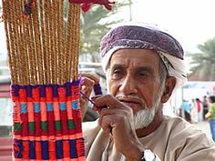 a weaver makes a traditional sling used for climbing palm trees.