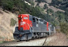 SP's East Pleasanton Turn was descending Altamont Pass through Niles Canyon westbound led by a pair of boiler equipped SD9's kept in captive Bay area service for commuter train backup power.