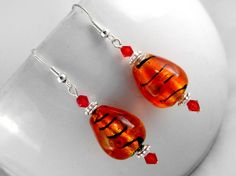 Maple Earrings $10.00 - Ladies beaded earrings. Murano glass beads, Swarovski crystal, and Tibet silver on silver plated wire.