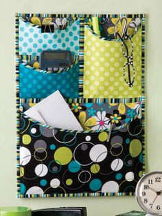 Sewing Secrets: 6 Projects For The Sewing Room pocket wall organizer in the p. - Sewing Secrets: 6 Projects For The Sewing Room pocket wall organizer in the picture is my fave! Sewing Hacks, Sewing Tutorials, Sewing Patterns, Sewing Ideas, Quilt Patterns, Fabric Crafts, Sewing Crafts, Creation Couture, Fabric Storage