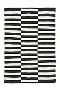 Woven from natural cotton with a geometric print, this rug can be used as a decorative addition to any room in your home. The trendy design will certa