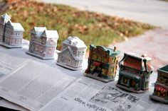 Dollar Store Frosted White Christmas Village using cheap white spray paint that lets some color show thru