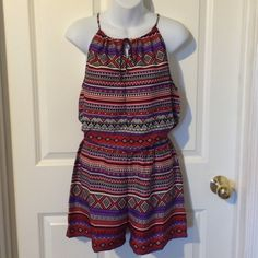Red/Purple Tribal Keyhole Halter Romper Cute and easy to wear, lightweight romper in great tribal print. Halter style top with keyhole tie front. Elastic waist. 100% polyester. Pants Jumpsuits & Rompers