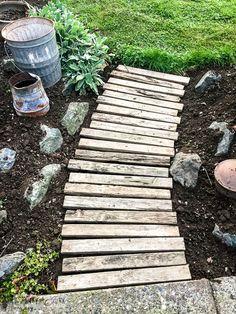 a freshly weeded pallet wood garden walkway / funkyjunkinteriors.net