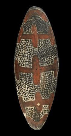 The front of one of a pair of similar Aboriginal shields from Nowra, NSW (Oc.1809). Displayed at the London International Exhibition, 1862. Entered by Henry Moss. Purchased by Henry Christy after the exhibition. Both were later gifted to the British Museum.