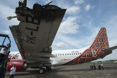 Officials at Halim Perdanakusuma Airport in Jakarta inspect the broken wing of a Batik Air plane, Tuesday (05/04). The plane collided with another airplane operated by Trans Nusa on the runway just before take-off on Monday night. Three air traffic controllers employed by AirNav Indonesia are facing a three-week suspension over the incident. (Antara Photo/Widodo S Jusuf)