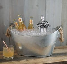 Octopus Ice Scoop. Rope Beverage Tub. Cast aluminum ice scoop features a detailed Octopus handle. Galvanized beverage tub is accented with heavy duty rope handles.