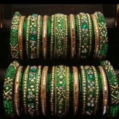 Green bangles! Like the variety of design and size in the bangles. [Bangles]